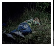 """Ahmed, 6 years old HORGOS, SERBIA. It is after midnight when Ahmed falls asleep in the grass. The adults are still sitting around, formulating plans for how they are going to get out of Hungary without registering themselves with the authorities. Ahmed is six years old and carries his own bag over the long stretches that his family walks by foot. """"He is brave and only cries sometimes in the evenings,"""" says his uncle, who has taken care of Ahmed since his father was killed in their hometown Deir ez-Zor in northern Syria."""