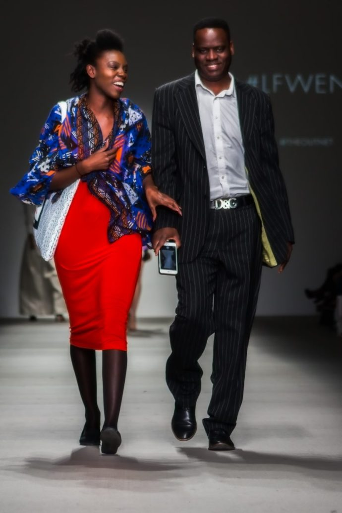 couple walking the catwalk at London Fashion weekend 2015.
