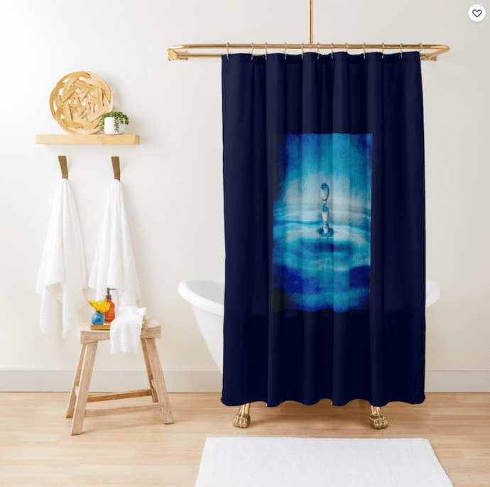 Shower curtain with a blue water drop design