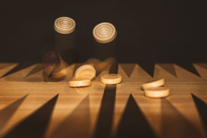backgammon game with pieces falling
