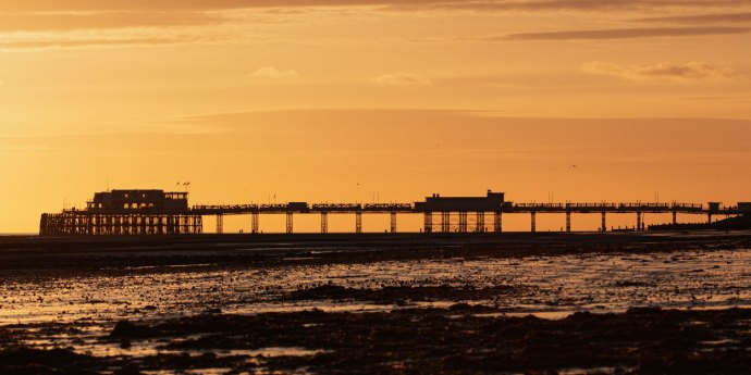Worthing Pier in silhouette at sunset