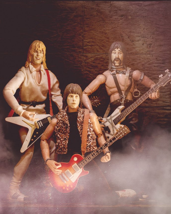 Still life image of the spinal tap characters for joyous June