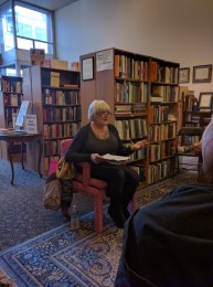 Antonette Rea sharing her work at her poetry reading at Bison Books
