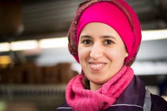 14. A girl with a pink head scarf (Marché des enfants rouges)