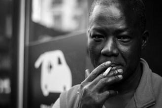 21. A man enjoying his cigarette break (rue de Busi, Paris 6)
