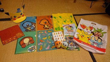 We came home with some pokemon folders, some plushes, and a little hand towel. They also gave me a super cute Pikachu Halloween hat and some fliers and bags.