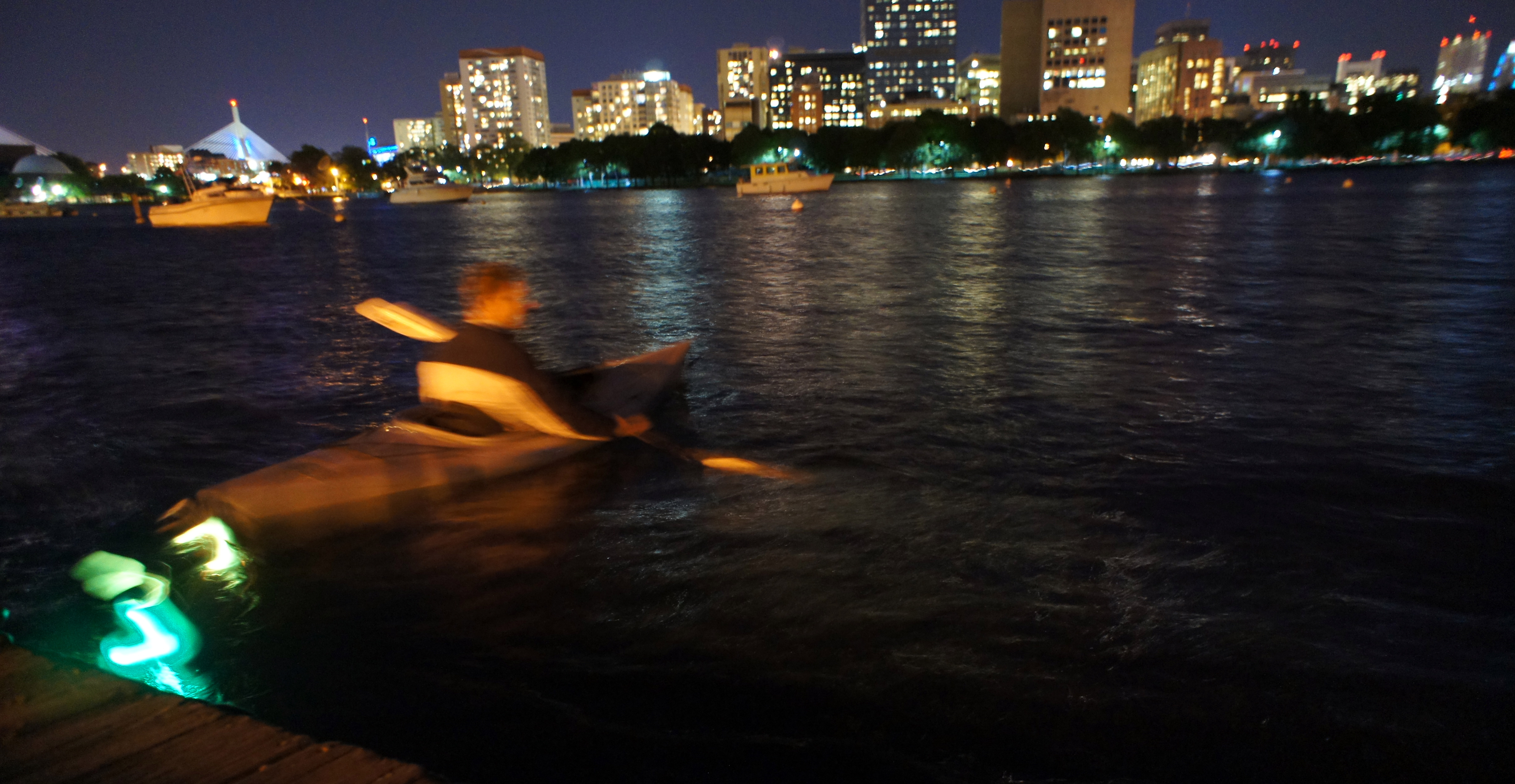 A kayak towing the bobs on the Charles River, Boston, 2014.