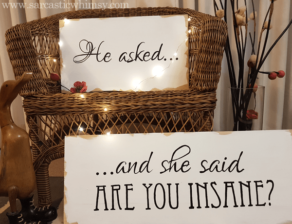 Design and make your own personalised sign with your response to his big question to display on your wedding day.