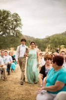 My beautiful mother walking down the aisle with my now brother