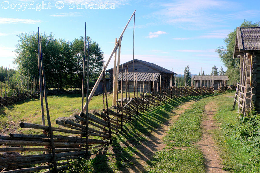 Traditional Finnish fence and a shadoof