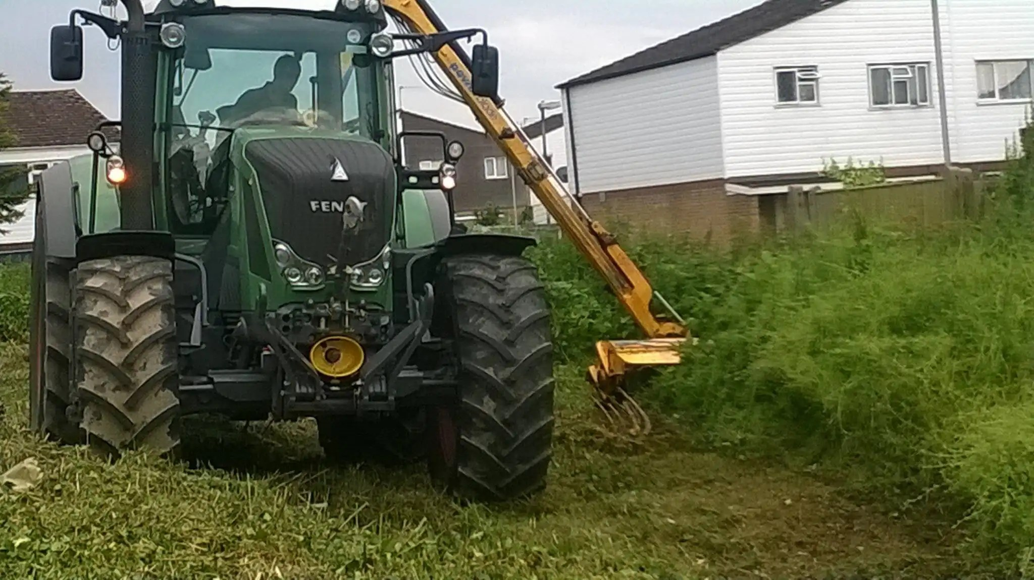 Tractor fitted with hedgecutter