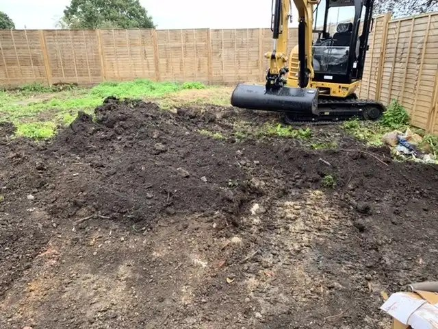 Digging off the topsoil for the car park extension