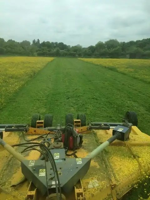Agricultural contractors in Bracknell topping a grass paddock