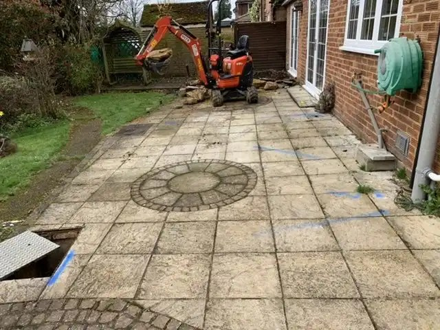 Midi excavator digging footings, groundwork services