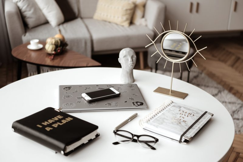 table with planner computer and glasses
