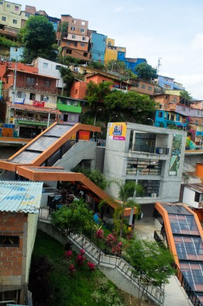 It's good to not have to walk or take long bus rides, but the escalators have only helped a small part of the Comuna 13 population and cost loads of money in maintenance, money that is argued to better be spent on livelihood improvements for the whole community.