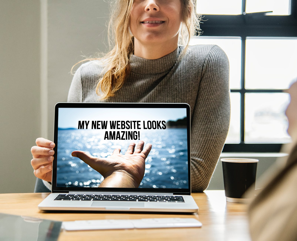 woman proudly displayin gher new website