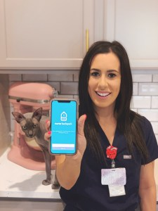 nurse holding cell phone