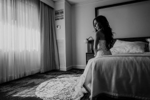 black and white bride on bed