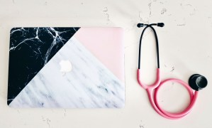 pink stethoscope and black marble macbook case
