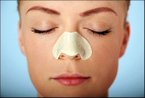 How To Prevent Blackheads - Woman Using Pore Strip