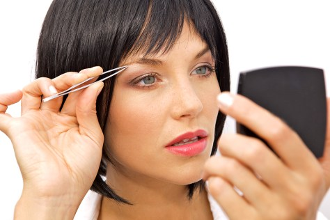 Choosing The Right Tweezers Woman Tweezing Eyebrows