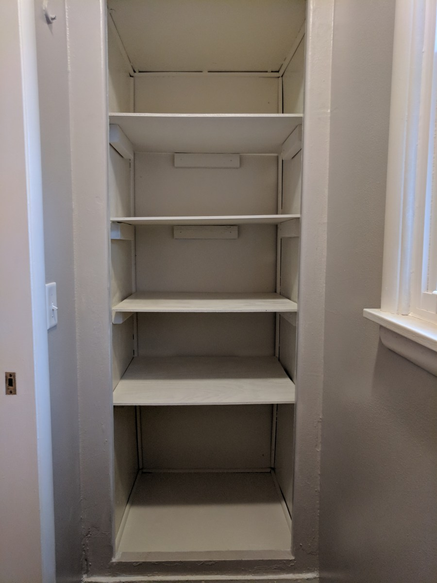Bathroom closet painted installed shelves
