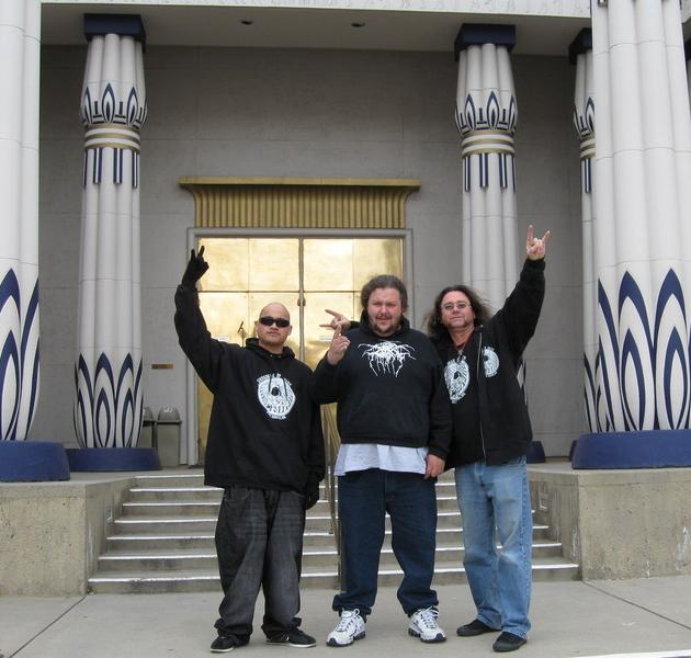 The Mad Poet, Knife, and the Reverend of the Dark Side in front of the Rosicrucian Temple
