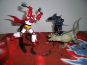 This isn't really a crossover because Getter actually fights dinosaurs in the anime/manga, but it's still kind of awesome.