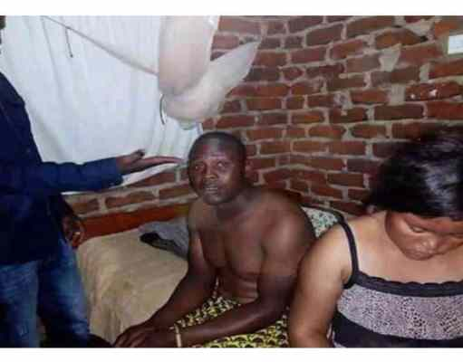 A man rips cheating wife's stomach open as her boyfriend watches