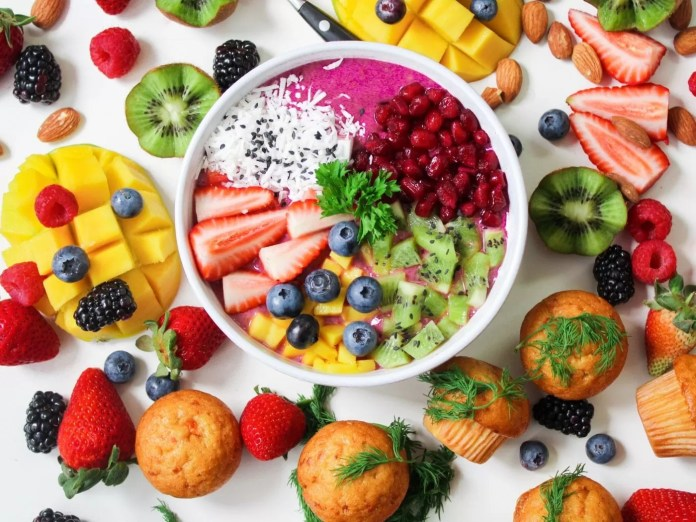Delicious food garnished with fresh fruits