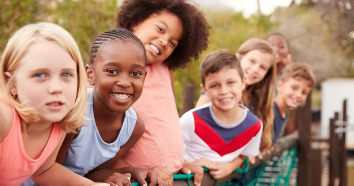 Group of kids standing cheerfully