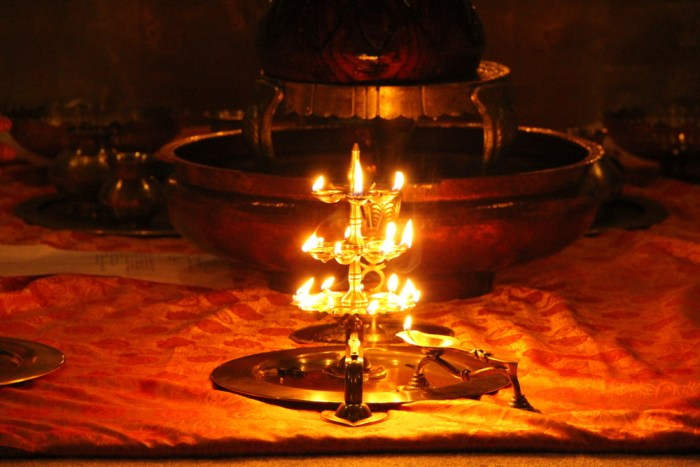 Offering oil lamp (deepam) druing puja