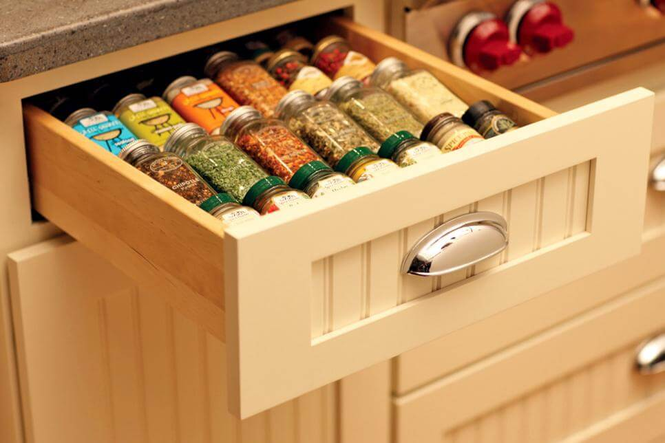 spices in a drawer instead of a wall-mounted rack
