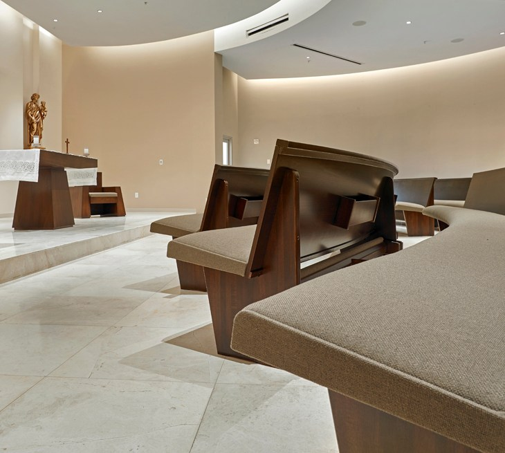 Sauder Worship Upholstered Radial Pews in church