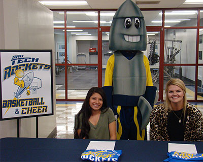 Two young girls and rocket mascot
