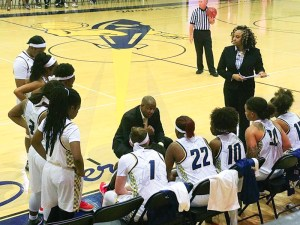Coaches and female bball players