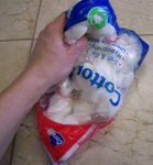 Kneading the cotton through the bag distributes the petroleum jelly while keeping your hands clean.