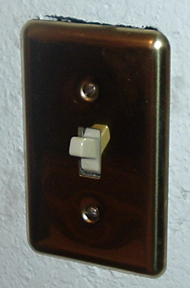 The new switchplate wasn't big enough to cover the entire opening.