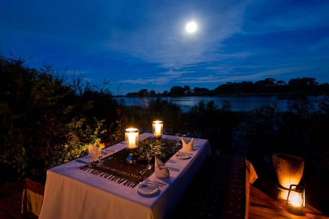 Dining under a full moon on Sindabezi Island, just above Victoria Falls. Photo credit: Tongabezi Lodge.