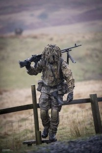 Camo machine gunner