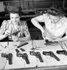 Women cleaning guns browning high power