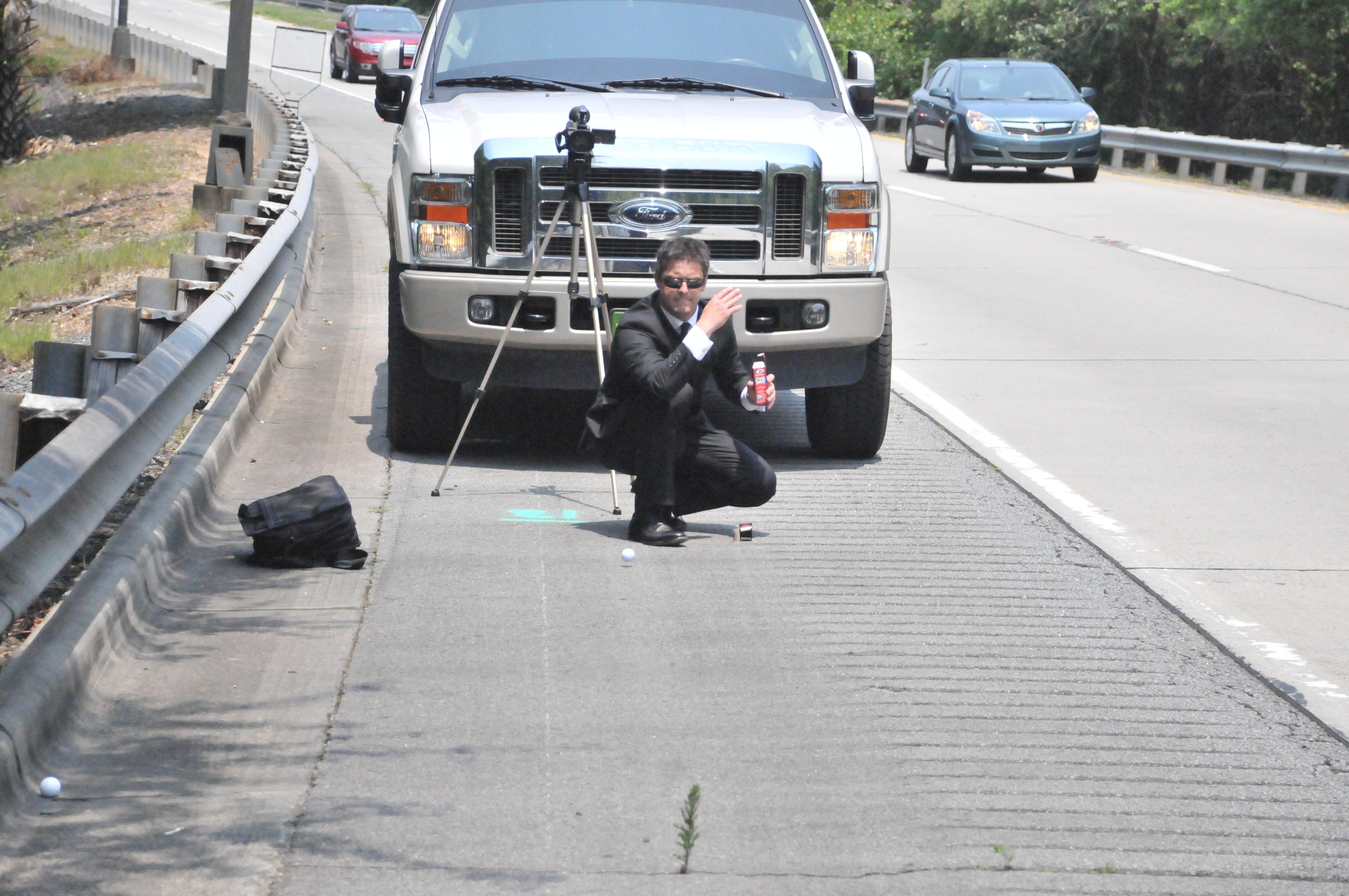 Working - Jason Cerbone, Savannah DUI lawyer rolling golf ball on road - Cerbone DUI Defense