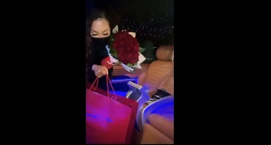 Khanyi Mbau holding her gifts