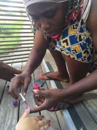 Mama Abdul painting my fingernails