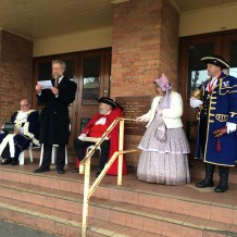 1956 Mayor Nathaniel Callow (Hedley Thomson), watched by 2016 Mayor Des Hudson, to his left, and Town Crier Brian Whykes on right, and other members of the Australasian Guild of Town Criers.