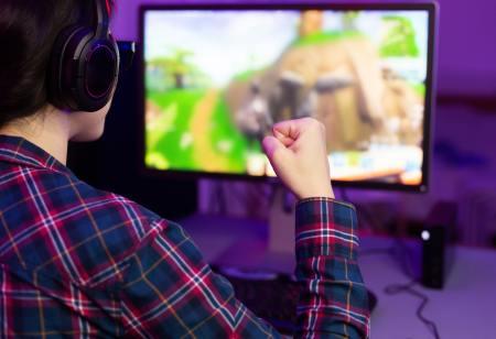 Female gamer winning in online video game