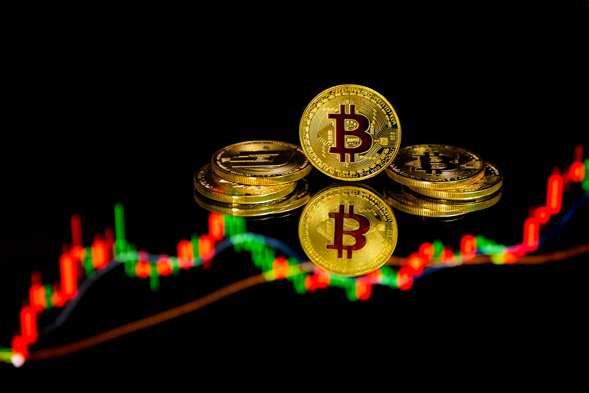 Bitcoin coins with global trading exchange market price chart in the background