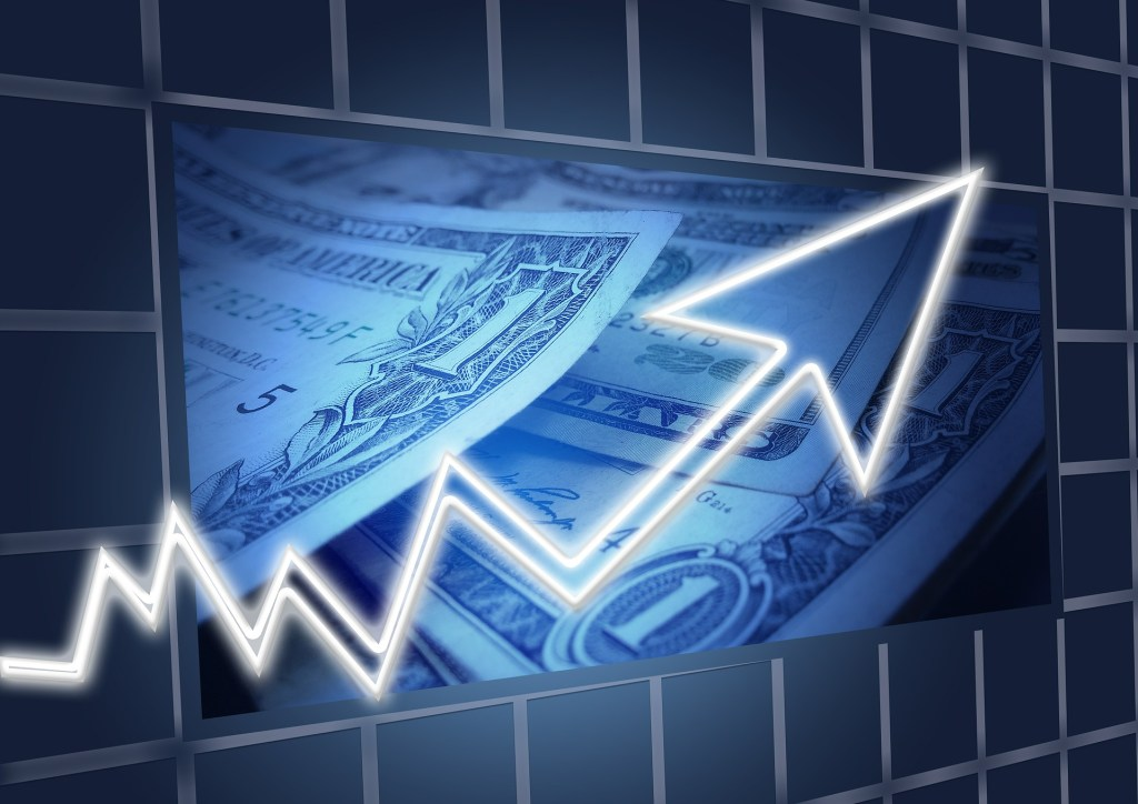graphical image of american money banknote and stock market arrow showing up