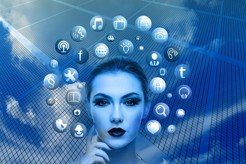 graphical image of woman head surrounded by social media icons